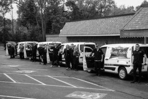 catering staff standing in front of Mario Fazio's restaurant vans