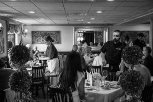 diners and wait staff at Mario Fazio's restaurant